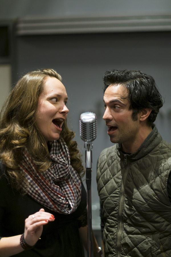"""Sarah Jeanette Taylor and David Joseph rehearse for """"It's A Wonderful Life: A Live Radio Play,' (photo by Ava G. Lindenmaier)."""