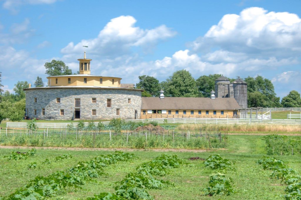 Gardens with Round Stone Barn and Dairy Ell, Hancock Shaker Village; Photo by Bestbudbrian; [CC BY-SA 4.0 (https://creativecommons.org/licenses/by-sa/4.0)], via Wikimedia Commons