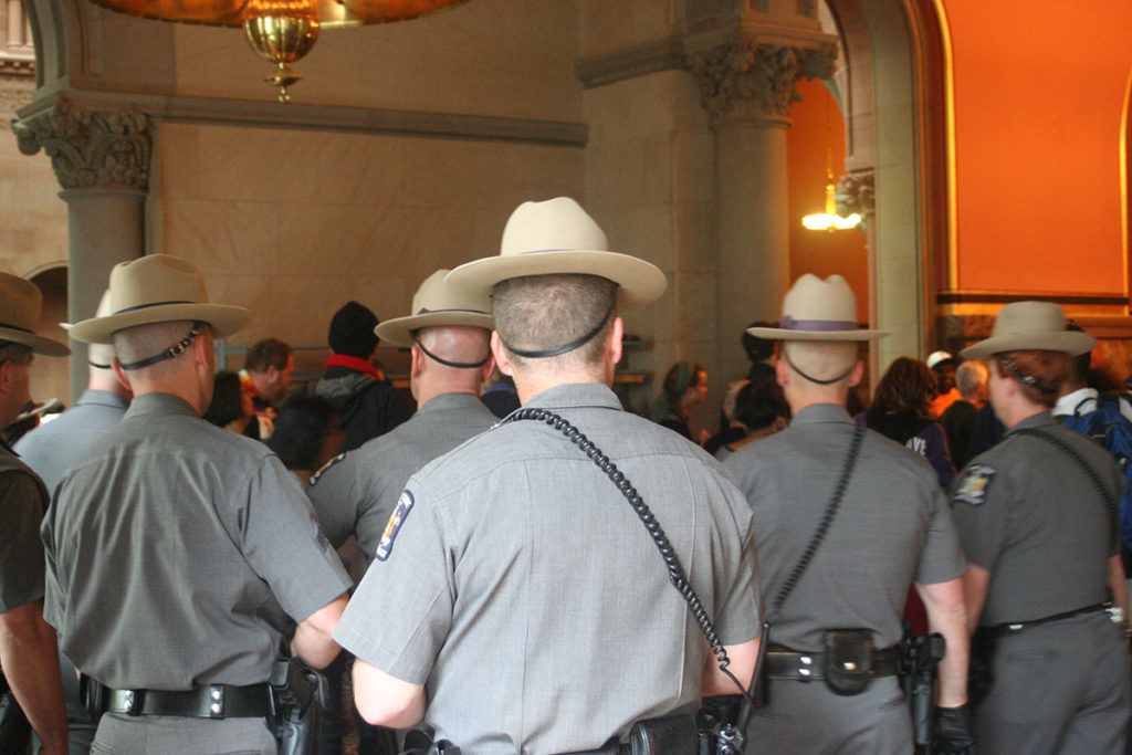 A no-foolin'-around sized force of City of Albany and New York State Capitol police was on hand at the June 4 Poor People's Campaign event. Some twenty-seven arrests were made for trespassing and disturbing the peace; photo by Jason Velázquez.