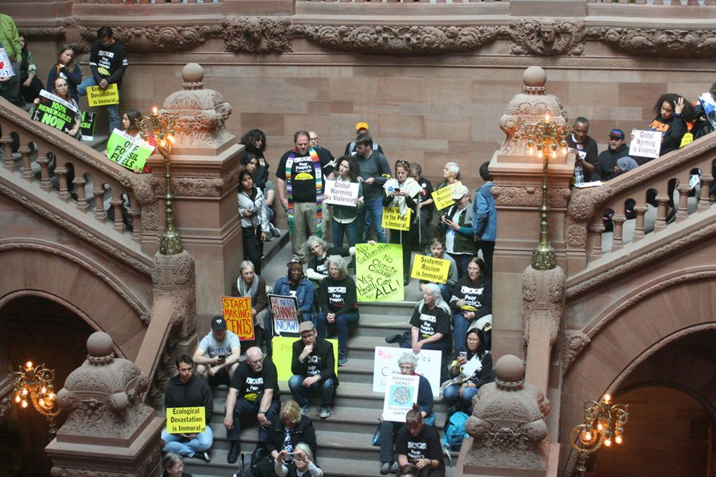 """Demonstrators occupy the """"Million Dollar Stairway"""" in the Capitol Building in Albany, New York June 4, 2018; photo by Jason Velázquez."""